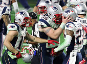 Wide receiver Julian Edelman of the New England Patriots celebrates with strong safety Patrick Chung and wide receiver Julian Edelman during Super...