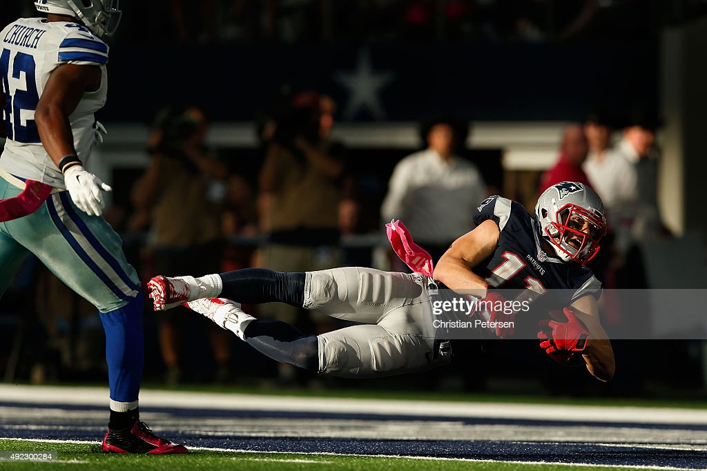 Wide receiver Julian Edelman #11 of the New England Patriots dives into the end zone to score on a 59 yard touchdown reception against the Dallas Cowboys during the second half of the NFL game at AT&T Stadium on October 11, 2015 in Arlington, Texas.