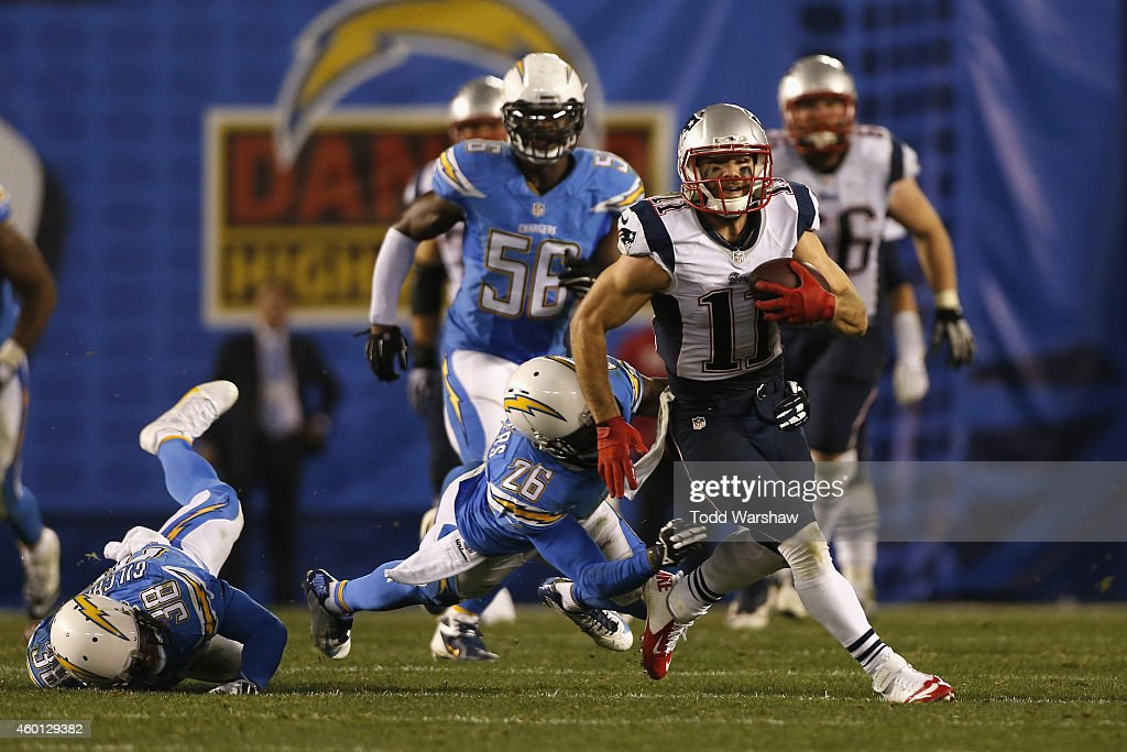 Wide receiver <a gi-track='captionPersonalityLinkClicked' href=/galleries/search?phrase=Julian+Edelman&family=editorial&specificpeople=4489543 ng-click='$event.stopPropagation()'>Julian Edelman</a> #11 of the New England Patriots scores a 66-yard touchdown after breaking free from cornerback <a gi-track='captionPersonalityLinkClicked' href=/galleries/search?phrase=Brandon+Flowers+-+American+Football+Player&family=editorial&specificpeople=7270342 ng-click='$event.stopPropagation()'>Brandon Flowers</a> #26 of the San Diego Chargers at Qualcomm Stadium on December 7, 2014 in San Diego, California.