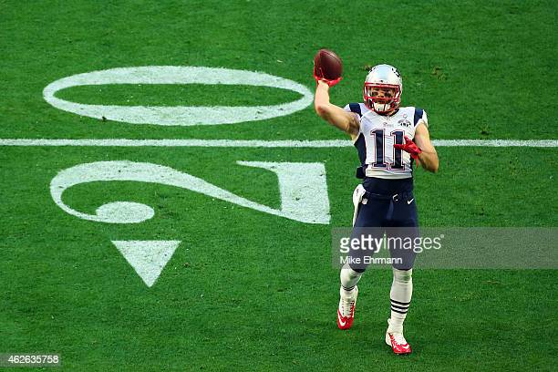 Wide receiver Julian Edelman of the New England Patriots warms up prior to Super Bowl XLIX against the Seattle Seahawks at University of Phoenix...