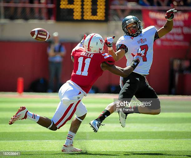 Wide receiver Julian Jones of the Arkansas State Red Wolves and cornerback Andrew Green of the Nebraska Cornhuskers miss getting their hands on a...