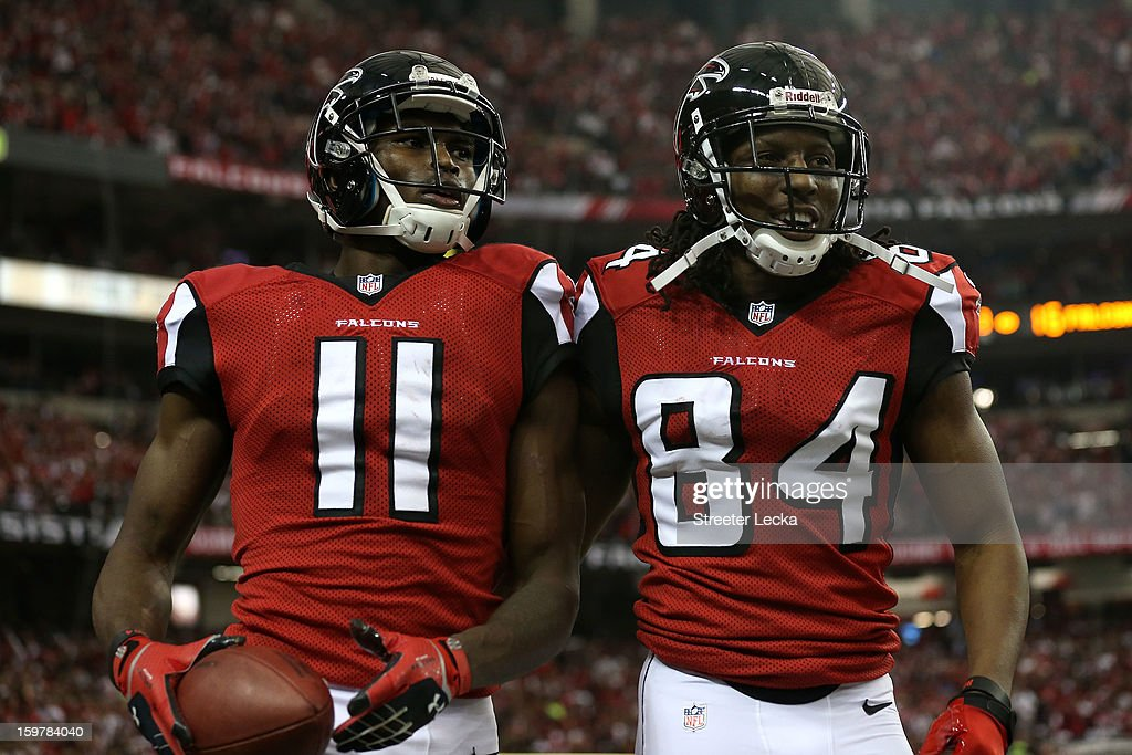 Wide receiver Julio Jones #11 and wide receiver Roddy White #84 of the Atlanta Falcons celebrate after Jones catches a 20-yard touchdown catch in the second quarter against the San Francisco 49ers in the NFC Championship game at the Georgia Dome on January 20, 2013 in Atlanta, Georgia.