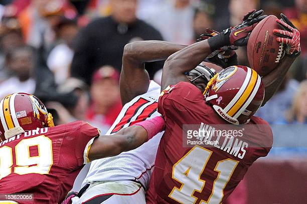 Wide receiver Julio Jones of the Atlanta Falcons and safety Madieu Williams of the Washington Redskins fight for a pass in the end zone that was...