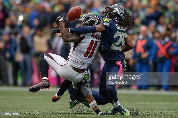 Wide receiver Julio Jones of the Atlanta Falcons can't make the catch on fourth down as cornerback Richard Sherman of the Seattle Seahawks defends at...