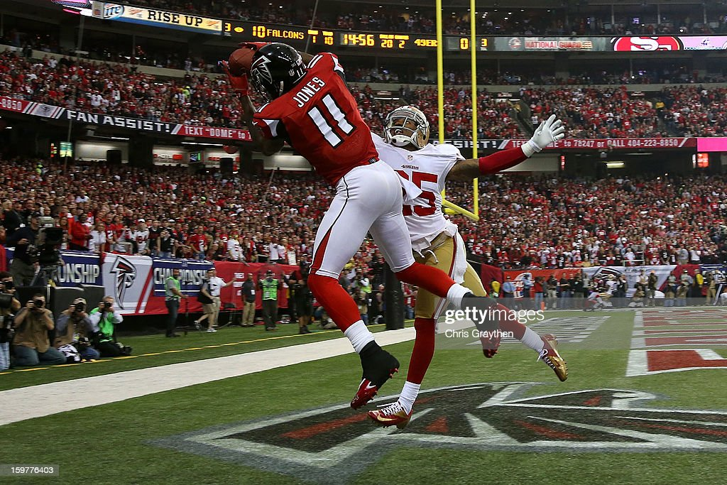 Wide receiver <a gi-track='captionPersonalityLinkClicked' href=/galleries/search?phrase=Julio+Jones&family=editorial&specificpeople=5509837 ng-click='$event.stopPropagation()'>Julio Jones</a> #11 of the Atlanta Falcons catches a 20-yard touchdown against cornerback <a gi-track='captionPersonalityLinkClicked' href=/galleries/search?phrase=Tarell+Brown&family=editorial&specificpeople=2105844 ng-click='$event.stopPropagation()'>Tarell Brown</a> #25 of the San Francisco 49ers in the second quarter in the NFC Championship game at the Georgia Dome on January 20, 2013 in Atlanta, Georgia.