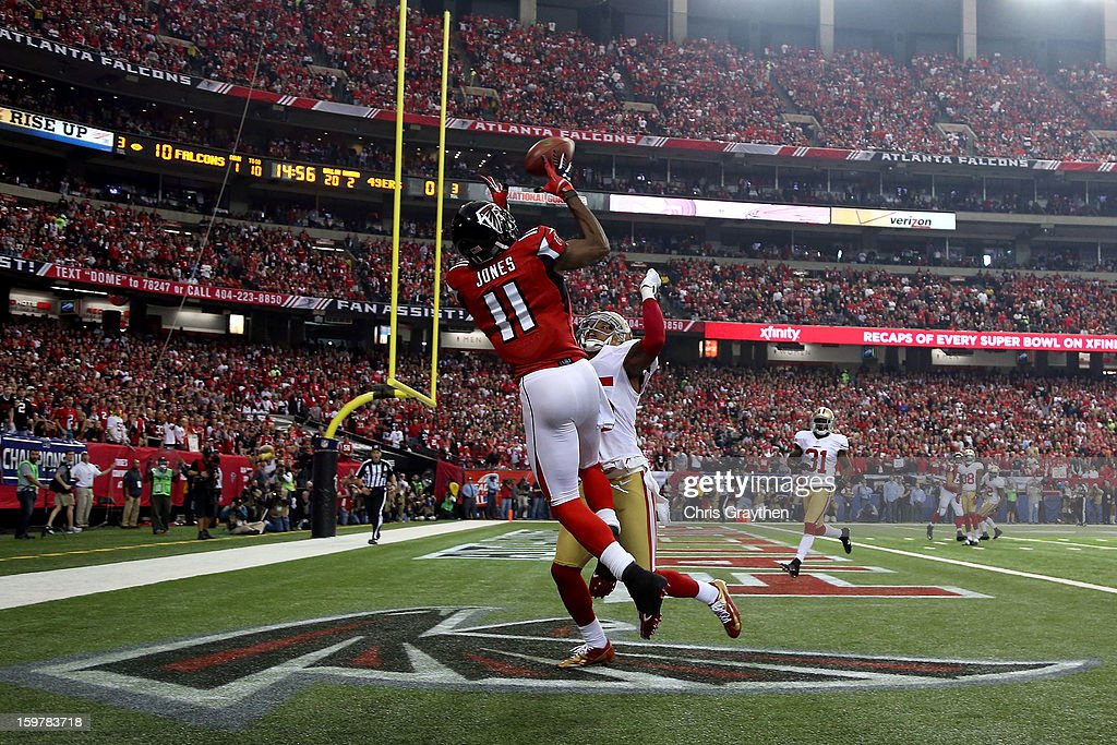 Wide receiver Julio Jones of the Atlanta Falcons catches a 20yard touchdown against cornerback Tarell Brown of the San Francisco 49ers in the second...