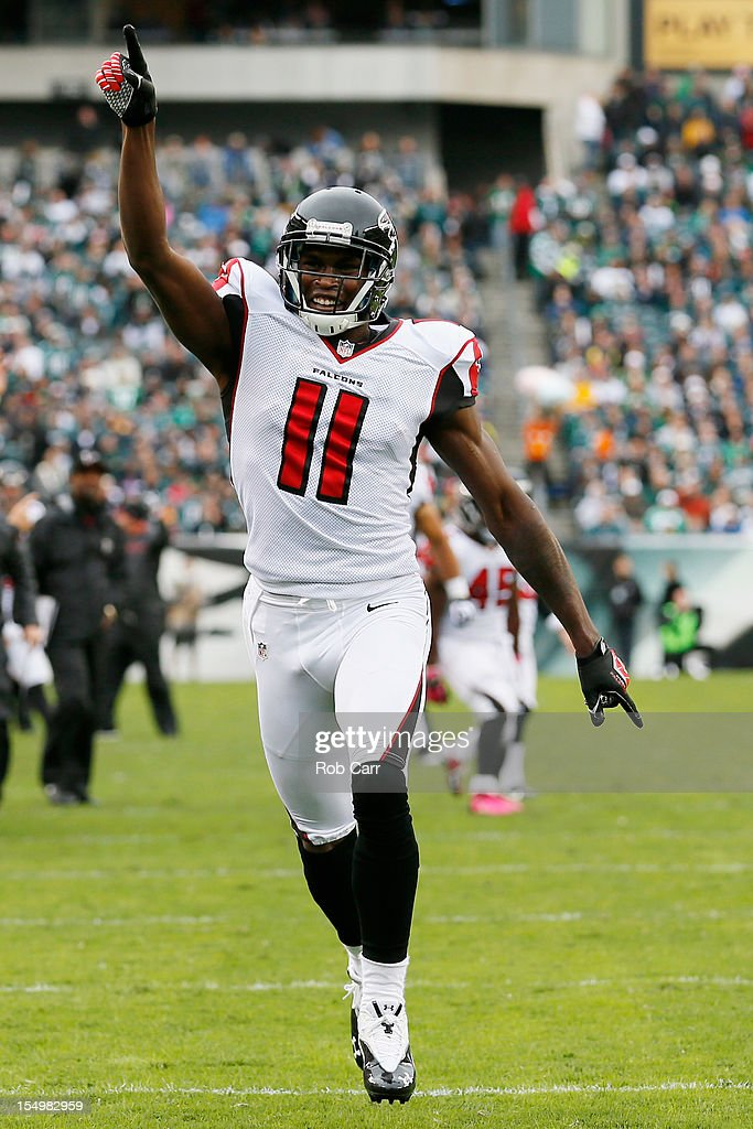 Wide receiver <a gi-track='captionPersonalityLinkClicked' href=/galleries/search?phrase=Julio+Jones&family=editorial&specificpeople=5509837 ng-click='$event.stopPropagation()'>Julio Jones</a> #11 of the Atlanta Falcons celebrates after the Falcons scored a first quarter touchdown against the Philadelphia Eagles at Lincoln Financial Field on October 28, 2012 in Philadelphia, Pennsylvania.