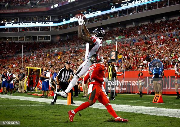 Wide receiver Julio Jones of the Atlanta Falcons hauls in a 3yard touchdown pass from quarterback Matt Ryan in front of cornerback Vernon Hargreaves...