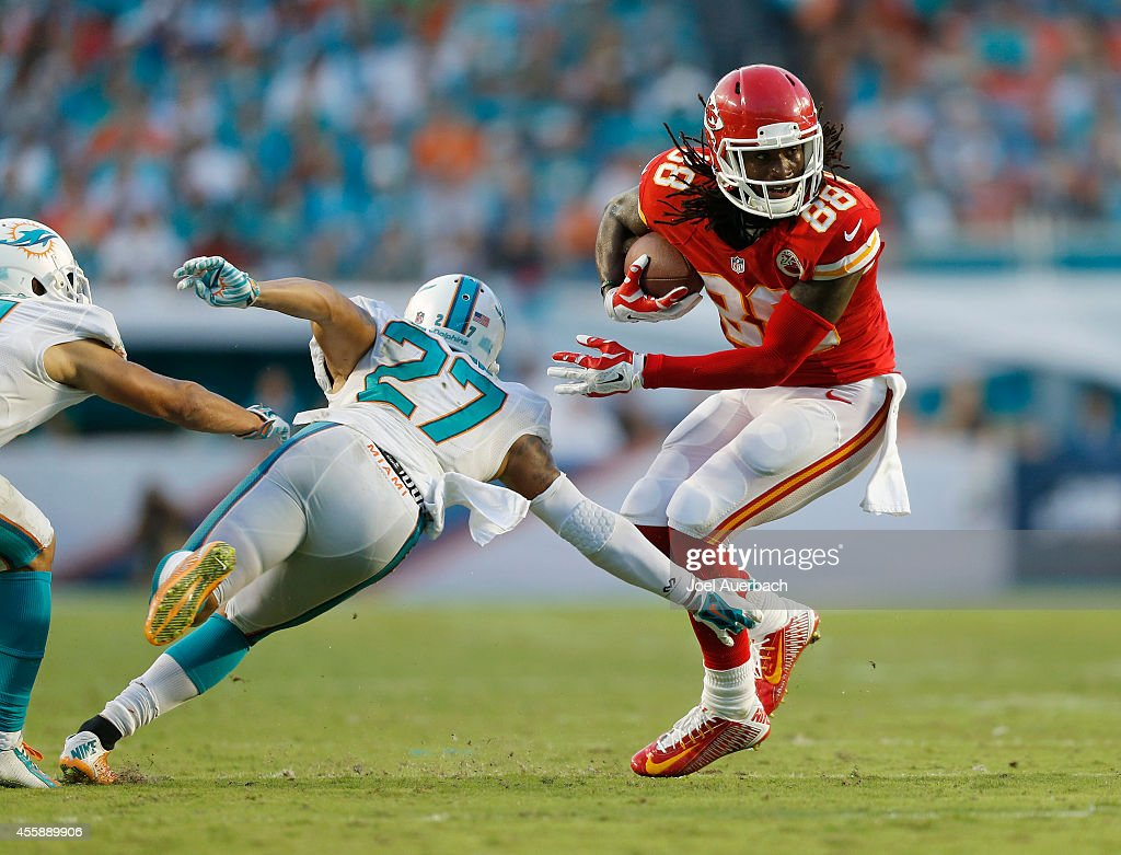 Wide receiver Junior Hemingway #88 of the Kansas City Chiefs looks for running romm against strong safety Jimmy Wilson #27 of the Miami Dolphins in the second half of a game at Sun Life Stadium on September 21, 2014 in Miami Gardens, Florida.