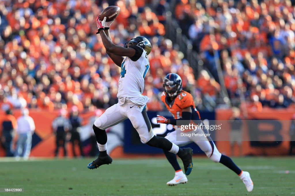 Wide receiver <a gi-track='captionPersonalityLinkClicked' href=/galleries/search?phrase=Justin+Blackmon&family=editorial&specificpeople=6236641 ng-click='$event.stopPropagation()'>Justin Blackmon</a> #14 of the Jacksonville Jaguars makes a first down pass reception as free safety <a gi-track='captionPersonalityLinkClicked' href=/galleries/search?phrase=Rahim+Moore&family=editorial&specificpeople=5510817 ng-click='$event.stopPropagation()'>Rahim Moore</a> #26 of the Denver Broncos defends at Sports Authority Field at Mile High on October 13, 2013 in Denver, Colorado. The Broncos defeated the Jaguars 35-19.