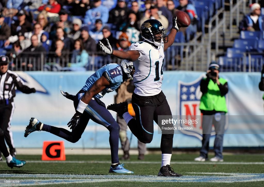 Wide receiver <a gi-track='captionPersonalityLinkClicked' href=/galleries/search?phrase=Justin+Blackmon&family=editorial&specificpeople=6236641 ng-click='$event.stopPropagation()'>Justin Blackmon</a> #14 of the Jacksonville Jaguars scores a touchdown against the Tennessee Titans December 30, 2012 in Nashville, Tennessee.