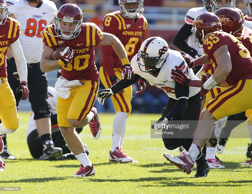 Wide receiver Justin Coleman #80 of the Iowa State Cyclones rushes for yards as linebacker Deion Imade #18 of the Oklahoma State Cowboys defends in the second half of play at Jack Trice Stadium on October 26, 2013 in Ames, Iowa. The Oklahoma State Cowboys defeated the Iowa State Cyclones 58-27.