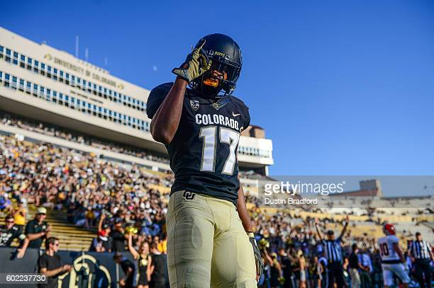 Wide receiver Kabion Ento of the Colorado Buffaloes celebrates after scoring a second half touchdown against the Idaho State Bengalsat Folsom Field...