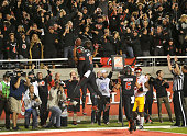 Wide receiver Kaelin Clay and Tim Patrick of the Utah Utes celebrate the winning touchdown against the USC Trojans at RiceEccles Stadium on October...