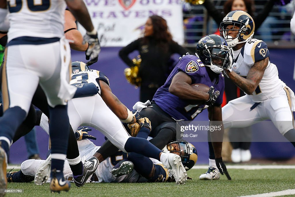 ... Wide receiver Kamar Aiken 11 of the Baltimore Ravens is tackled by  cornerback Marcus Roberson . ... 4223a0aec