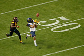 Wide receiver Ka'Raun White of the West Virginia Mountaineers catches a 53 yard reception past defensive back Kweishi Brown of the Arizona State Sun...