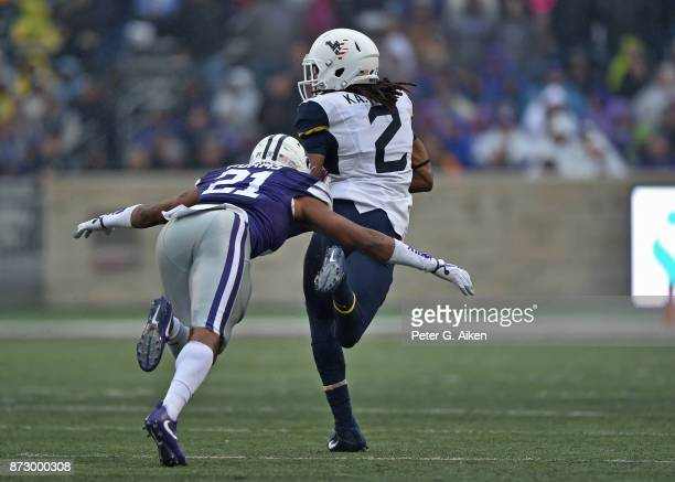 Wide receiver Ka'Raun White of the West Virginia Mountaineers catches a touchdown pass against defensive back Kendall Adams of the Kansas State...