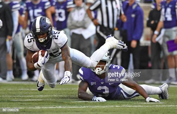 Wide receiver KaVontae Turgin of the TCU Horned Frogs gets tripped up from behind by linebacker Elijah Sullivan of Kansas State Wildcats during the...