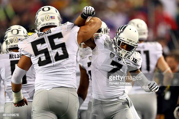 Wide receiver Keanon Lowe of the Oregon Ducks celebrates wit teammate Hroniss Grasu after catching a 7 yard touchdown thrown by quarterback Marcus...