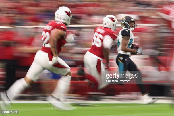 Wide receiver Keelan Cole of the Jacksonville Jaguars runs with the football after a reception past inside linebacker Karlos Dansby and free safety...