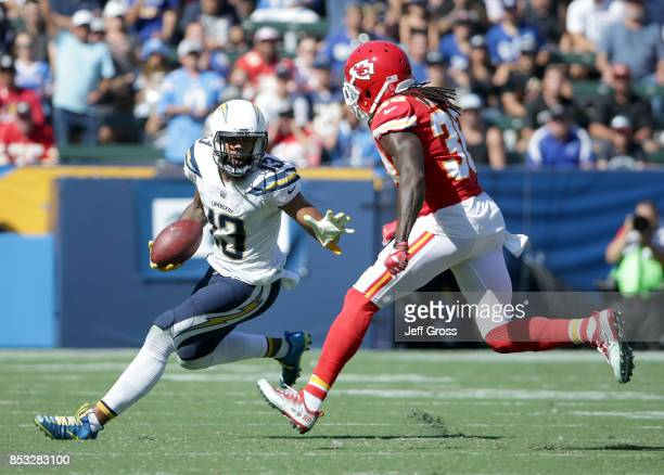 Wide receiver Keenan Allen of the Los Angeles Chargers is pursued by free safety Ron Parker of the Kansas City Chiefs for the ball in the second half...