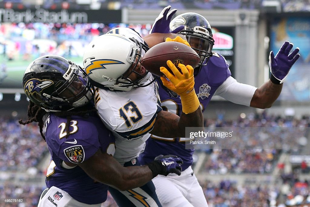 Wide receiver Keenan Allen #13 of the San Diego Chargers catches a touchdown pass in front of Kendrick Lewis #23 and Jimmy Smith #22 of the Baltimore Ravens during the second quarter at M&T Bank Stadium on November 1, 2015 in Baltimore, Maryland.