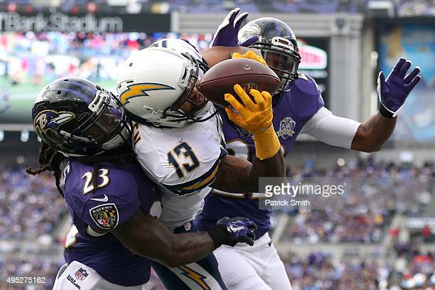 Wide receiver Keenan Allen of the San Diego Chargers catches a touchdown pass in front of Kendrick Lewis and Jimmy Smith of the Baltimore Ravens...