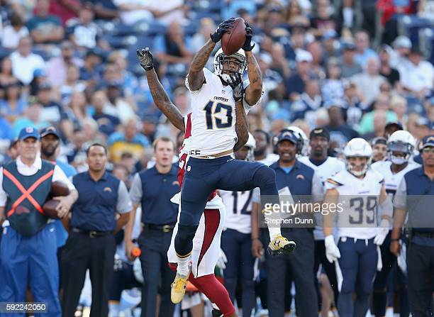 Wide receiver Keenan Allen of the San Diego Chargers makes a leaping catch over defensive back Brandon Williams of the Arizona Cardinals during...