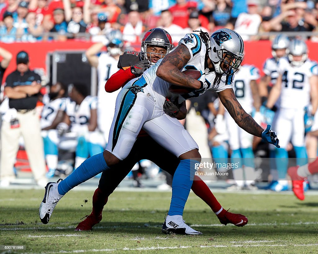 Wide receiver Kelvin Benjamin #13 of the Carolina Panthers is tackled by cornerback Javien Elliott #35 of the Tampa Bay Buccaneers after a catch during the game at Raymond James Stadium on January 1, 2017 in Tampa, Florida. The Buccaneers defeated the Panthers 17-16.
