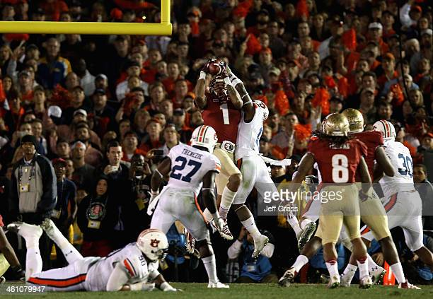 Wide receiver Kelvin Benjamin of the Florida State Seminoles catches a 2yard pass for a touchdown to take a 3331 lead in the final moments of the...