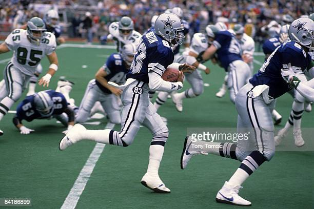 Wide receiver Kelvin Martin of the Dallas Cowboys runs with the ball during a game on October 23 1983 against the Philadelphia Eagles at Veteran's...