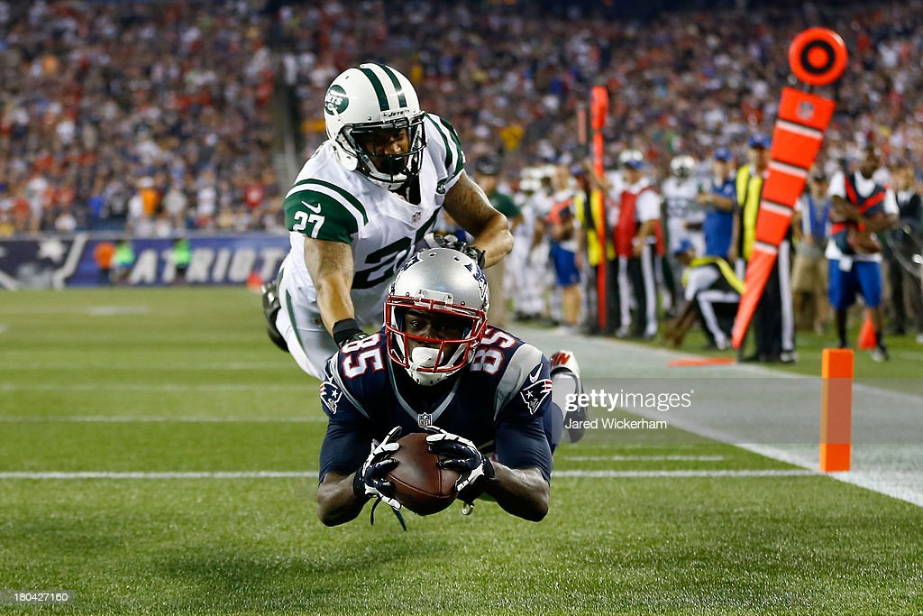 Wide receiver <a gi-track='captionPersonalityLinkClicked' href=/galleries/search?phrase=Kenbrell+Thompkins&family=editorial&specificpeople=8306063 ng-click='$event.stopPropagation()'>Kenbrell Thompkins</a> #85 of the New England Patriots drops a pass in the endzone against cornerback <a gi-track='captionPersonalityLinkClicked' href=/galleries/search?phrase=Dee+Milliner&family=editorial&specificpeople=7425020 ng-click='$event.stopPropagation()'>Dee Milliner</a> #27 of the New York Jets in the second quarter at Gillette Stadium on September 12, 2013 in Foxboro, Massachusetts.