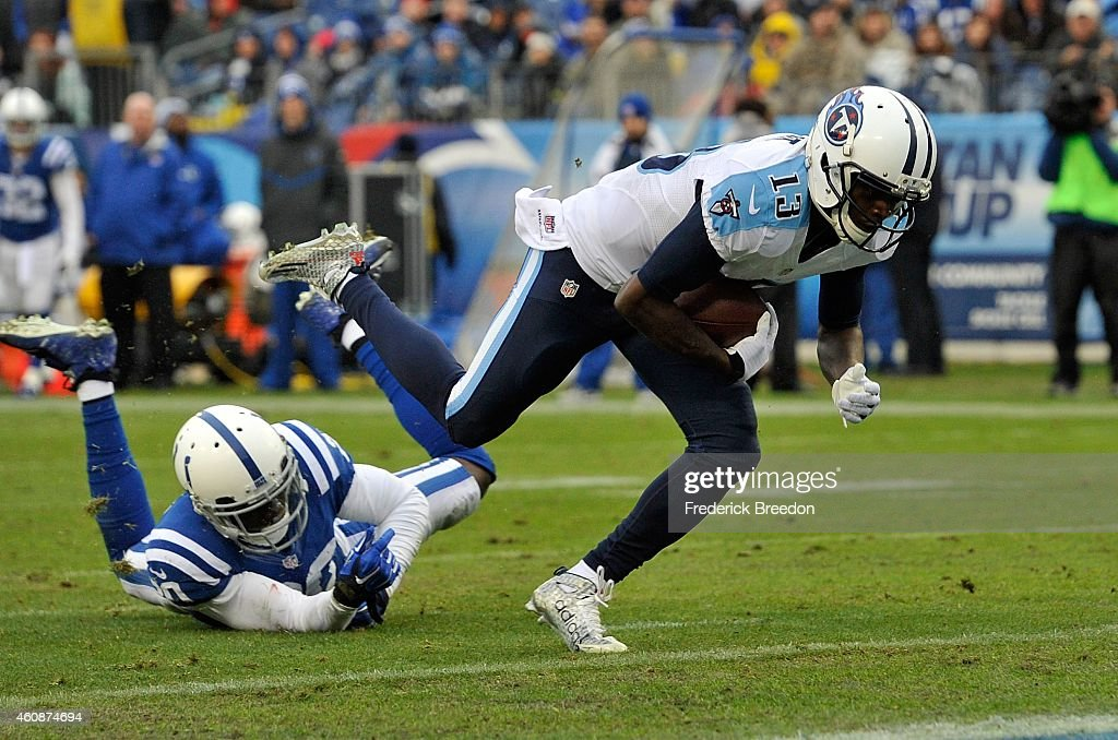 Wide receiver Kendall Wright #13 of the Tennessee Titans dives into the end zone to score a touchdown against the Indianapolis Colts during the second quarter of a game at LP Field on December 28, 2014 in Nashville, Tennessee.