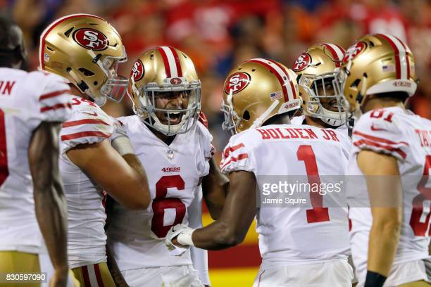 Wide receiver Kendrick Bourne of the San Francisco 49ers is congratulated by teammates after catching a pass for a touchdown during the preseason...