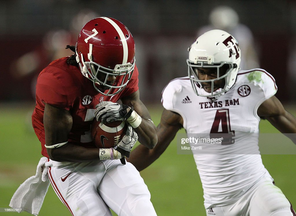Wide receiver Kenny Bell #7 of the Alabama Crimson Tide makes a reception behind defensive back Toney Hurd Jr. #4 of the Texas A&M Aggies during the game at Bryant-Denny Stadium on November 10, 2012 in Tuscaloosa, Alabama.