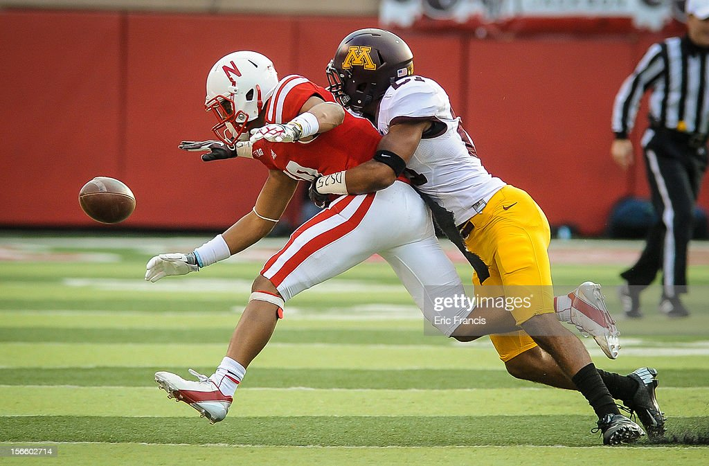 Wide receiver Kenny Bell #80 of the Nebraska Cornhuskers has the ball knocked away by defensive back Cedric Thompson #27 of the Minnesota Golden Gophers during their game at Memorial Stadium on November 17, 2012 in Lincoln, Nebraska.