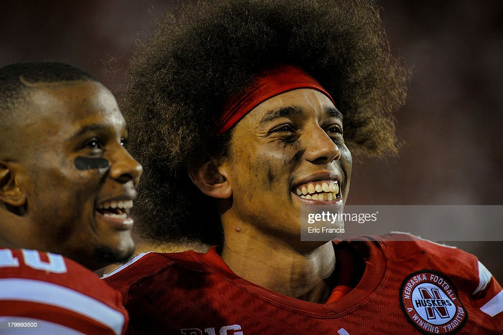 Wide receiver Kenny Bell #80 of the Nebraska Cornhuskers laughs with teammate wide receiver Jamal Turner #10 on the sidelines during their game against the Southern Miss Golden Eagles at Memorial Stadium on September 7, 2013 in Lincoln, Nebraska. Nebraska defeated Southern Miss 56-13.