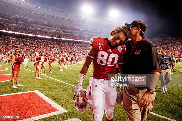 Wide receiver Kenny Bell of the Nebraska Cornhuskers receives congratulations from position coach Rich Fisher after their game against the Miami...