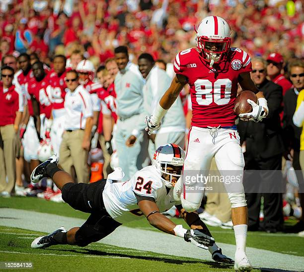 Wide receiver Kenny Bell of the Nebraska Cornhuskers runs away from defensive back Phillip Pleasant of the Idaho State Bengals to score a touchdown...