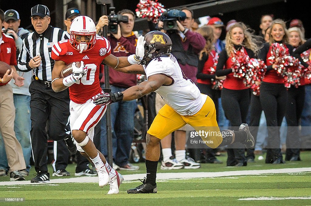 Wide receiver Kenny Bell #80 of the Nebraska Cornhuskers tries to hold off linebacker Keanon Cooper #4 of the Minnesota Golden Gophers during their game at Memorial Stadium on November 17, 2012 in Lincoln, Nebraska.