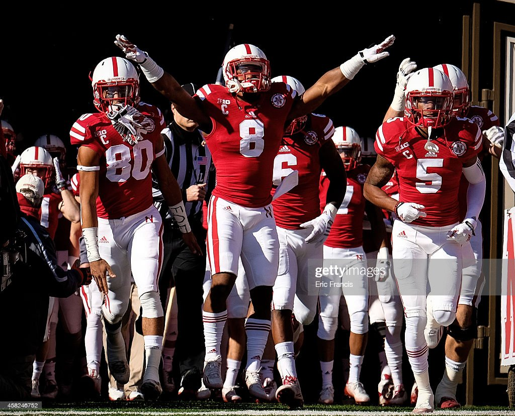 Wide receiver <a gi-track='captionPersonalityLinkClicked' href=/galleries/search?phrase=Kenny+Bell+-+American+Football+Player&family=editorial&specificpeople=14580138 ng-click='$event.stopPropagation()'>Kenny Bell</a>, running back <a gi-track='captionPersonalityLinkClicked' href=/galleries/search?phrase=Ameer+Abdullah&family=editorial&specificpeople=8199967 ng-click='$event.stopPropagation()'>Ameer Abdullah</a> and cornerback Josh Mitchell #5 of the Nebraska Cornhuskers lead the captains on the field before their game against the Purdue Boilermakers at Memorial Stadium on November 1, 2014 in Lincoln, Nebraska. Nebraska defeated Purdue 35-14.