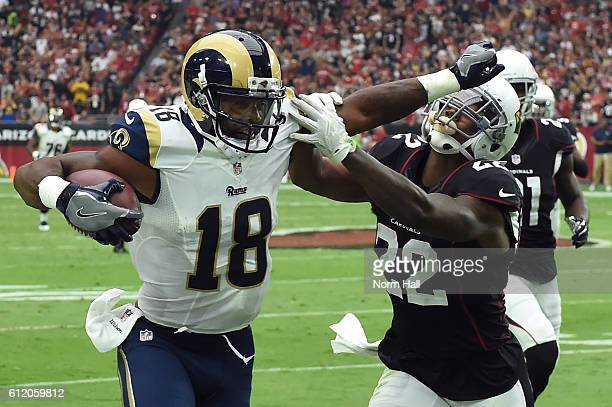 Wide receiver Kenny Britt of the Los Angeles Rams makes a catch against strong safety Tony Jefferson of the Arizona Cardinals in the first half of...