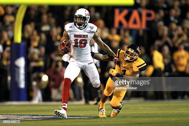 Wide receiver Kenny Golladay of the Northern Illinois Huskies gets away form cornerback Cheatham Norrils of the Toledo Rockets during the first...