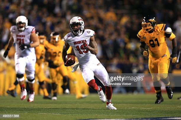 Wide receiver Kenny Golladay of the Northern Illinois Huskies runs the ball after making a catch during the fourth quarter against the Toledo Rockets...