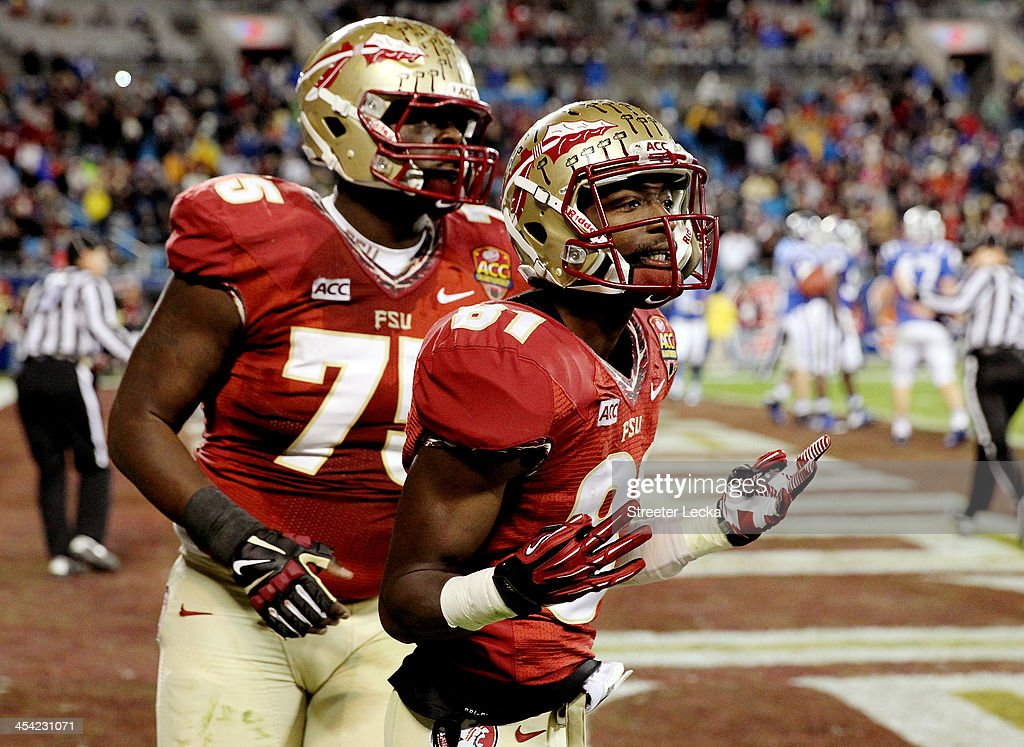 Wide receiver Kenny Shaw #81 and offensive linesman Cameron Erving #75 of the Florida State Seminoles celebrate against the Duke Blue Devils during the ACC Championship game at Bank of America Stadium on December 7, 2013 in Charlotte, North Carolina.