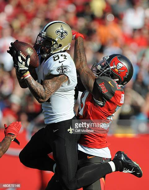 Wide receiver Kenny Stills of the New Orleans Saints catches a pass over defensive end William Gholston of the Tampa Bay Buccaneers in the third...