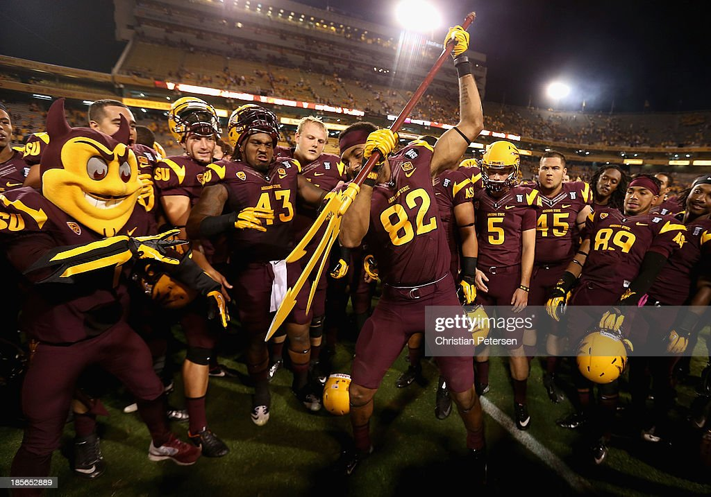 Wide receiver Kevin Ozier #82 of the Arizona State Sun Devils spikes the pitch fork in celebration after defeating the Washington Huskies in the college football game at Sun Devil Stadium on October 19, 2013 in Tempe, Arizona. The Sun Devils defeated the Huskies 53-24.