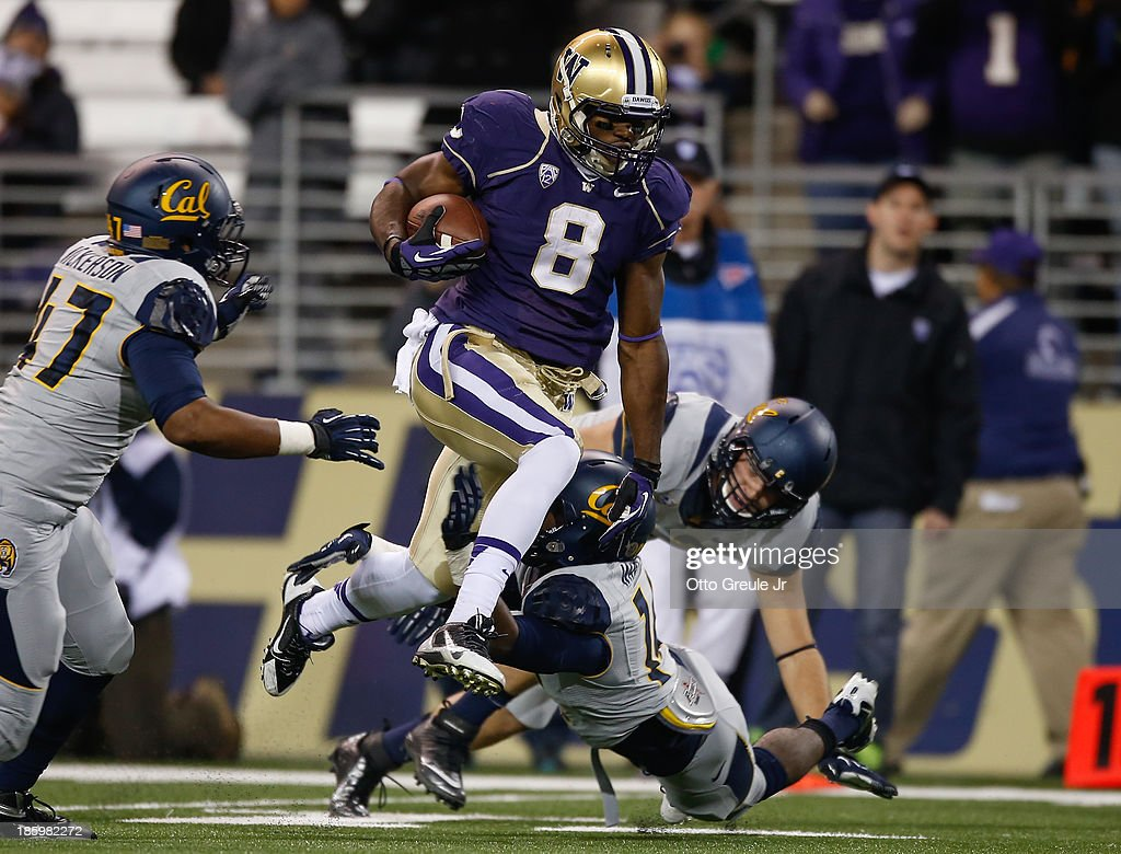 Wide receiver Kevin Smith #8 of the Washington Huskies rushes against the California Golden Bears on October 26, 2013 at Husky Stadium in Seattle, Washington.