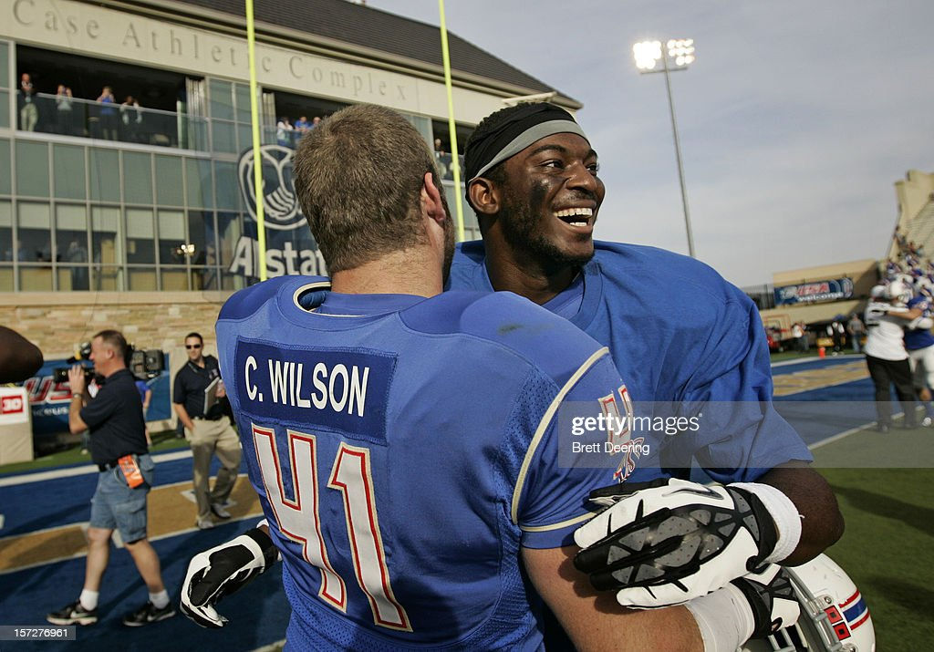 Wide receiver Khiry Cooper #4 and fullback Cody Wilson #41 of the Tulsa Golden Hurricane celebrate after the C-USA Championship against the Central Florida Knights on December 1, 2012 at H.A. Chapman Stadium in Tulsa, Oklahoma. Tulsa defeated Central Florida 33-27 in overtime.