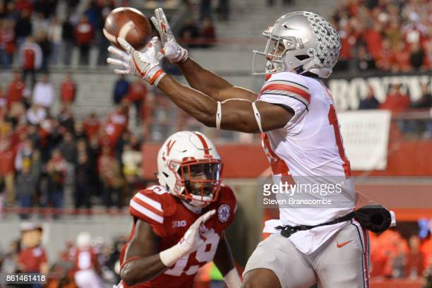 Wide receiver KJ Hill of the Ohio State Buckeyes grabs a touchdown pass against defensive back Marquel Dismuke of the Nebraska Cornhuskers at...